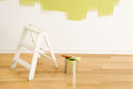 Still life of paintbrush on paint can with stepladder painted wall. Stock Photo - 2043769