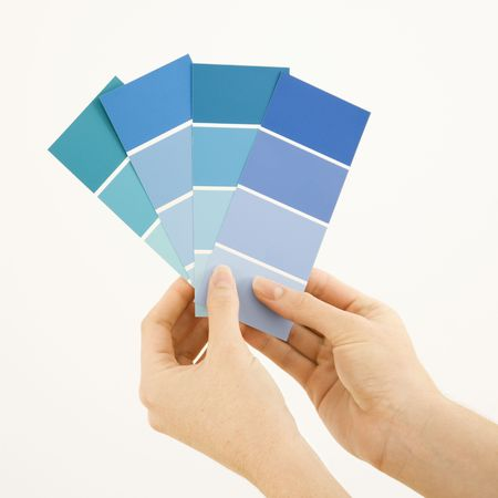 Caucasian female hands holding paint color swatches. Stock Photo - 2043983