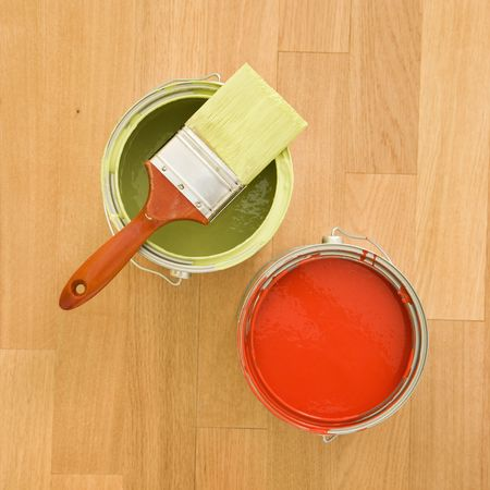 High angle of paintbrush with paint cans on wood floor. Stock Photo - 2043673