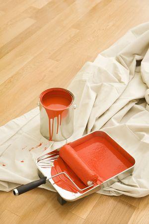 floor cloth: Painting supplies on drop cloth on wood floor. Stock Photo