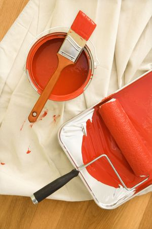 High angle view of painting supplies on drop cloth on wood floor. Stock Photo - 2043738