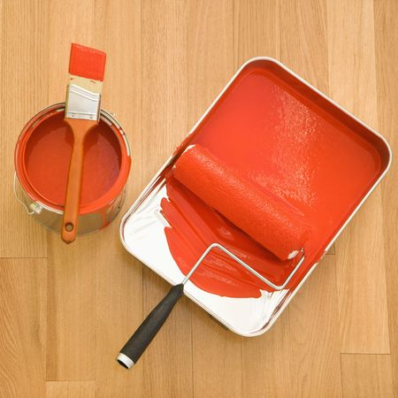 High angle of paint roller in tray with paint can on wood floor. Stock Photo - 2043547
