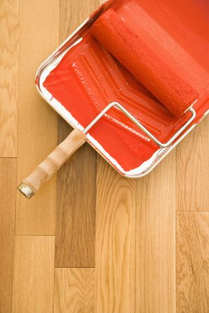 Still life of paint roller in tray on wood floor. Stock Photo - 2043571