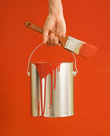 Caucasian female hand and leg holding paint can and paintbrush. Stock Photo - 2043710