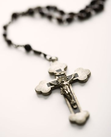 Christian rosary beads with crucifix on white background. photo