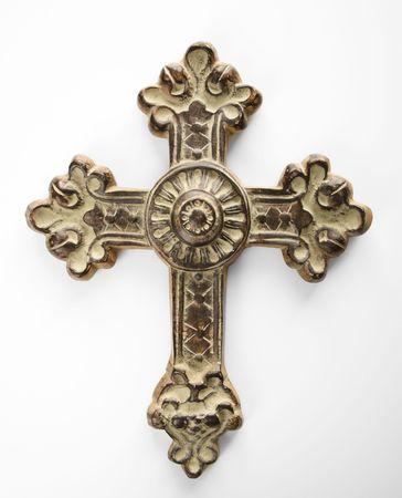 Ornamental religious cross against white background.