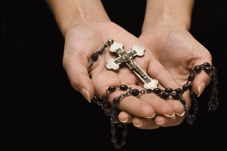 Woman's hands palm up cradling rosary with crucifix. Stock Photo - 2043663