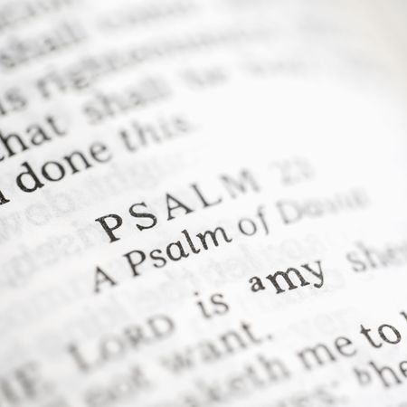 Selective focus of Psalm verses in open Holy Bible. photo