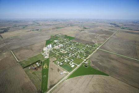 rural town: Aerial view of rural town surrounded by cropland and agriculture. Stock Photo