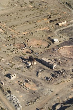 disrepair: Aerial view of abandoned industrial facility in state of disrepair.
