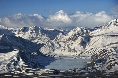 inyo national forest: Aerial of snowy mountain landscape with frozen lake in Inyo National Forest, California, USA. Stock Photo