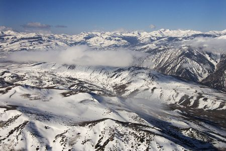 Aerial landscape of snow covered mountain range in Sweetwater\ Mountains, California, USA.