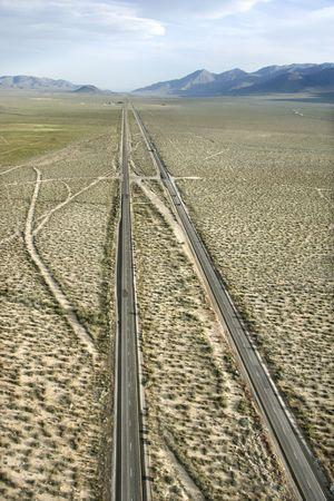 desolate: Aerial of desolate scenic highway through rural desert landscape of California, USA.