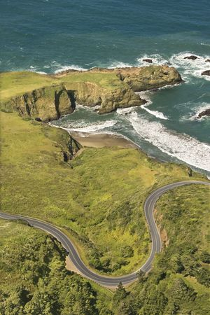 Aerial of winding road Shoreline Highway on west coast with Pacific Ocean in California, USA. photo