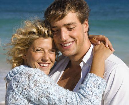 Happy smiling couple embracing on Maui, Hawaii beach. photo