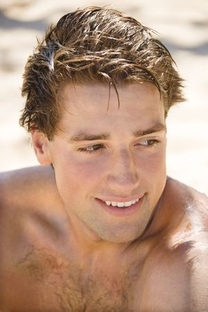 Head and shoulder portrait of handsome man on beach. Stock Photo - 2115301