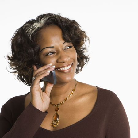 Portrait of woman holding telephone to ear and smiling. Stock Photo - 2115261