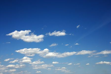 Fluffy clouds in blue sky. photo