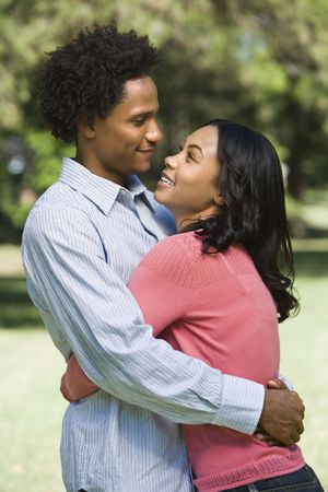 Attractive couple smiling and embracing in park. Stock Photo - 2115358