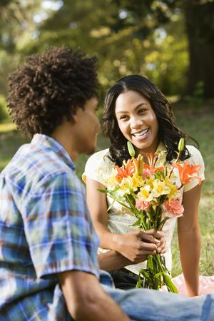 Man giving smiling woman bouquet of flowers. Stock Photo - 2115314