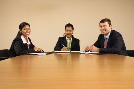 Business people sitting at conference table smiling. Stock Photo - 2113909