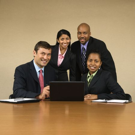 Businesspeople gathered around laptop computer smiling. Stock Photo - 2115226