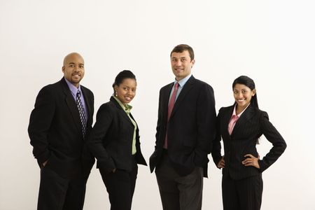 Portrait of businessmen and businesswomen standing smiling against white background. photo