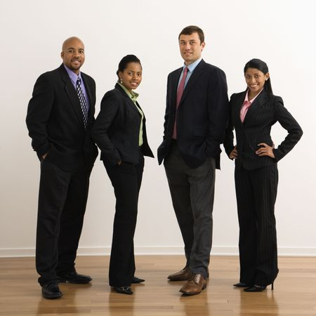 Portrait of businessmen and businesswomen standing smiling. photo