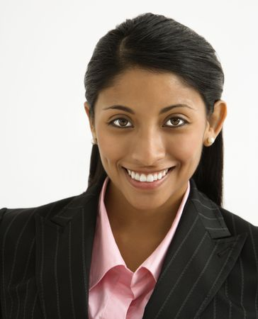 Portrait of smiling businesswoman against white background. photo