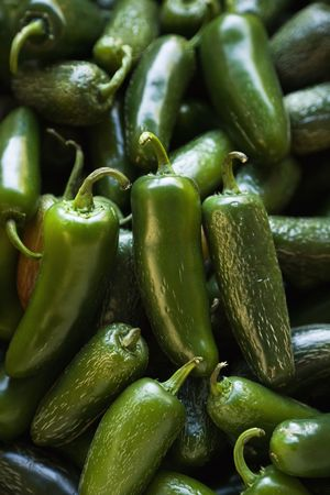 Pile of green jalapeno peppers at produce market. Stock Photo - 2095870