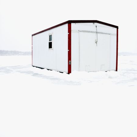Fish house on frozen Lake Green in Minnesota. Stock Photo - 2144828
