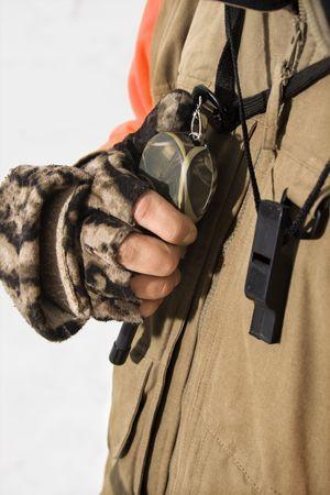 walkie talkie: Caucasian male hand holding walkie talkie.