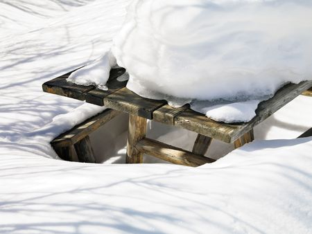 Picnic table covered in snow. Stock Photo - 2145428