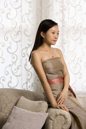 Portrait of an Asian woman in a bridesmaid dress. photo