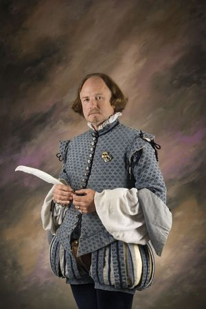bard: William Shakespeare in period clothing holding feather pen standing and looking at viewer.
