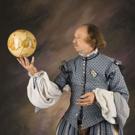 half globe: William Shakespeare in period clothing holding spinning globe. Stock Photo