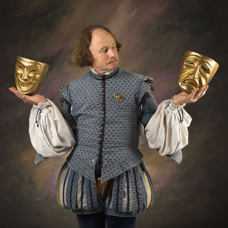 historical clothing: William Shakespeare in period clothing holding theatrical masks in either hand.