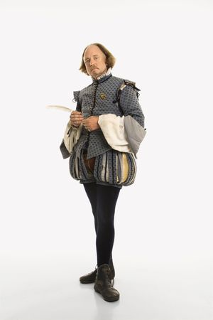 bard: William Shakespeare in period clothing holding feather pen looking at viewer. Stock Photo
