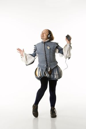 William Shakespeare in period clothing listening to mp3 player and dancing. photo