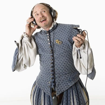 William Shakespeare in period clothing listening to mp3 player and smiling.. photo