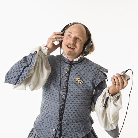 William Shakespeare in period clothing listening to mp3 player smiling. photo