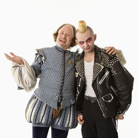william: William Shakespeare smiling with arm around gothic punk young man. Stock Photo
