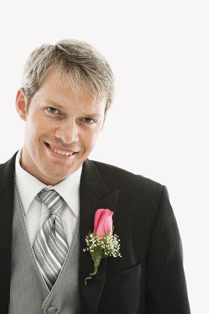 boutonniere: Portrait of Caucasian male in tuxedo with boutonniere. Stock Photo