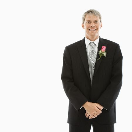 Portrait of Caucasian male in tuxedo with boutonniere. photo