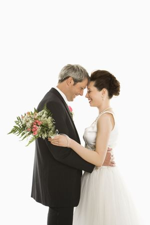 Portrait of Caucasian groom and Asian bride embracing Stock Photo - 2141643