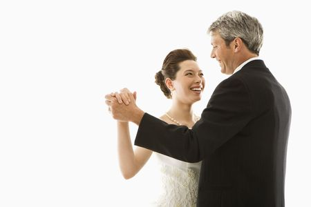 asian bride: Portrait of Caucasian groom and Asian bride dancing. Stock Photo
