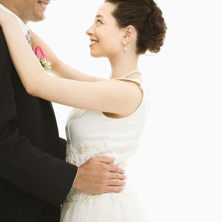 Caucasian groom and Asian bride dancing. Stock Photo - 2147417