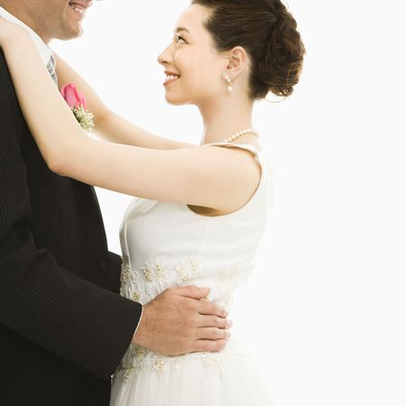 asian bride: Caucasian groom and Asian bride dancing. Stock Photo