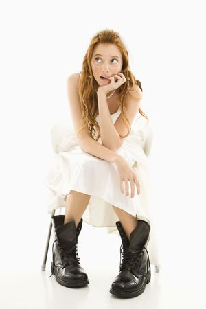 Portrait of Caucasian bride wearing combat boots and looking off to the side.