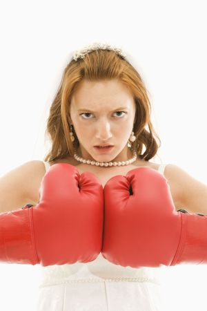 togther: Caucasian bride with boxing gloves togther.
